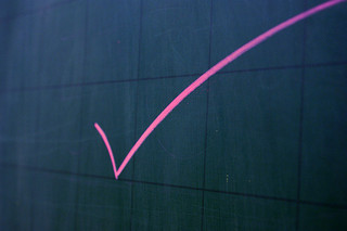 pink checkmark on black board