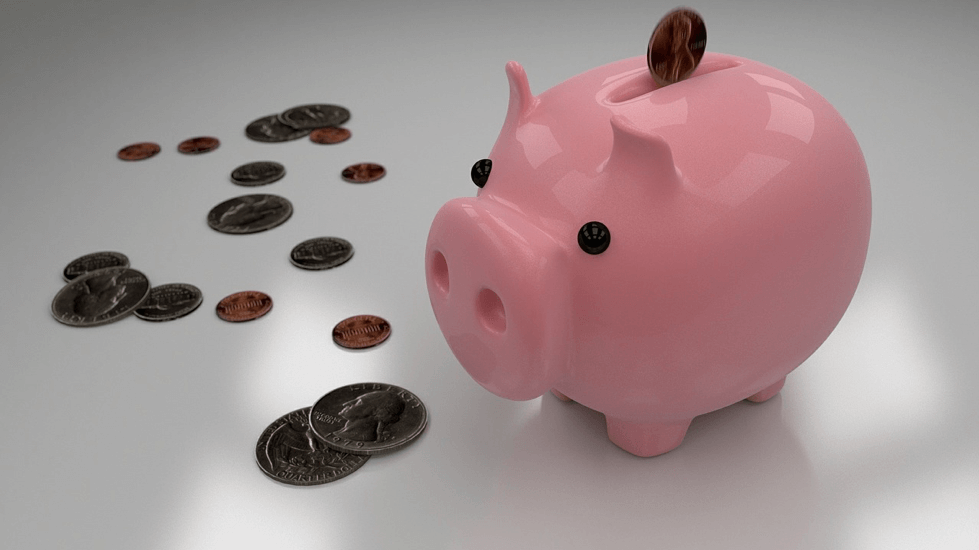 Pink piggybank with change