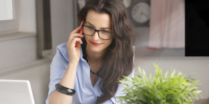 woman entrepreneur working at desk on phone