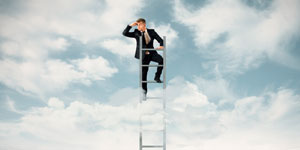 business man on ladder
