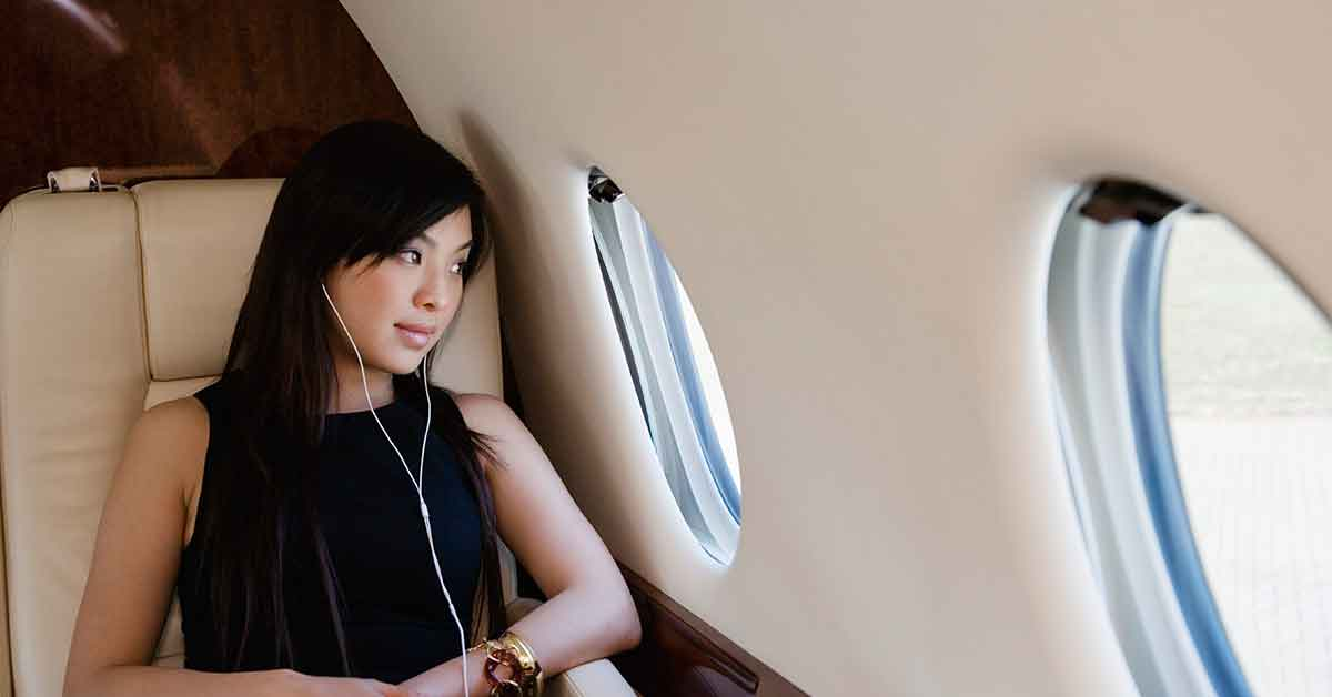 Women entrepreneur sitting on private plane | The Nobility of Women Entrepreneurship
