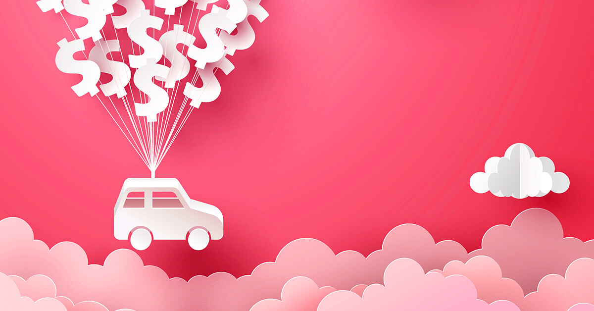 car hanging from balloons floating above the clouds