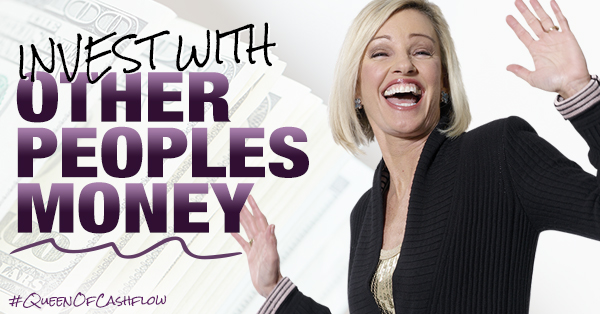 Kim Kiyosaki holding arms up signaling a touch down