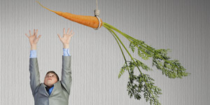 man jumping for a carrot