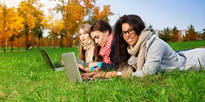 young women investing in grassy field