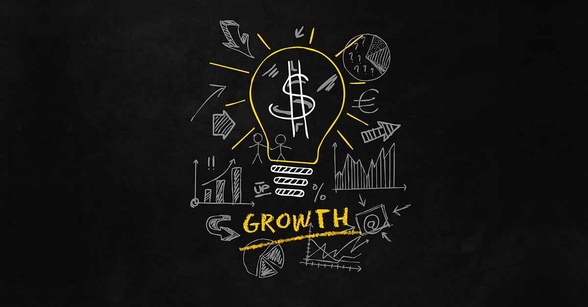 Drawings on chalk board that indicate financial growth.